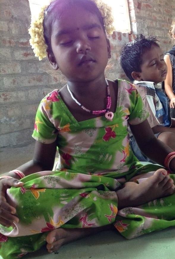Indian child meditating